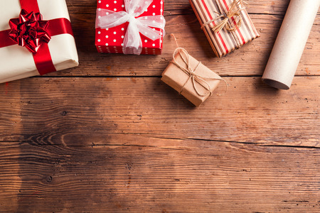 Christmas presents laid on a wooden table background Stok Fotoğraf
