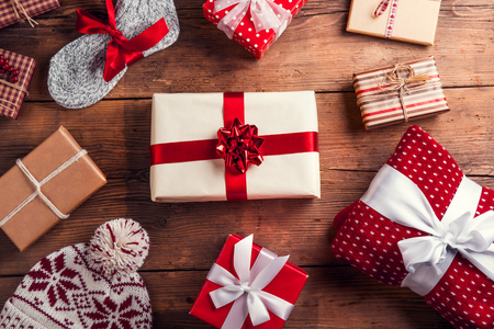 present: Christmas presents laid on a wooden table background Stock Photo