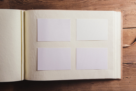 albums: Photo album with empty space. Studio shot on wooden background.