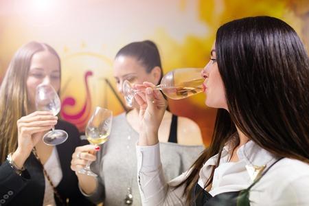 young group: Beautiful young women having fun outside in wine bar