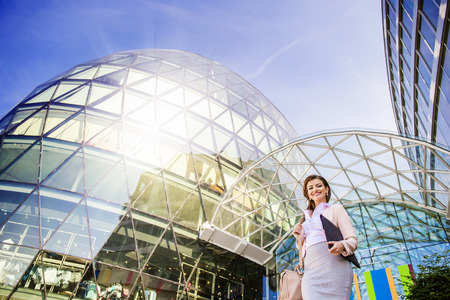 commercial building: Beautiful young business woman outside a modern building Stock Photo