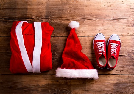 santa suit: Christmas composition. Studio shot on wooden background. Stock Photo