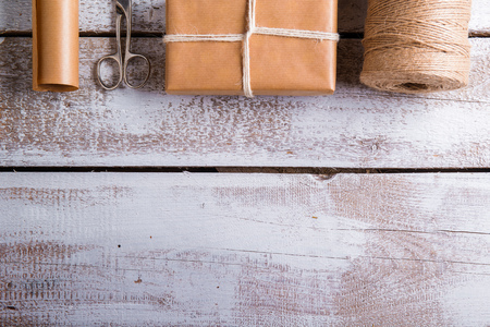 christmas presents: Christmas presents laid on a wooden table background Stock Photo