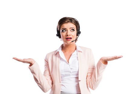 customer service: Attractive young business woman. Studio shot on white background.