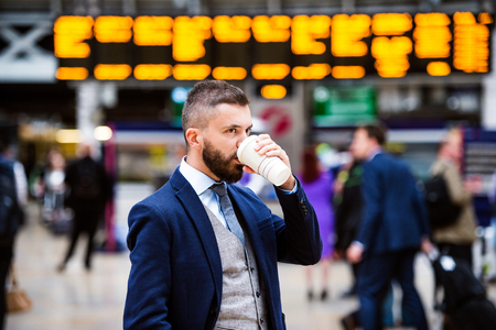 cool guy: Young handsome businessman with cup of coffee