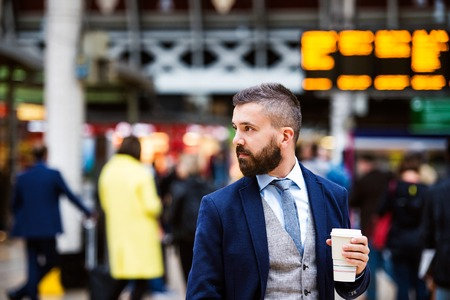 buss: Young handsome businessman with cup of coffee
