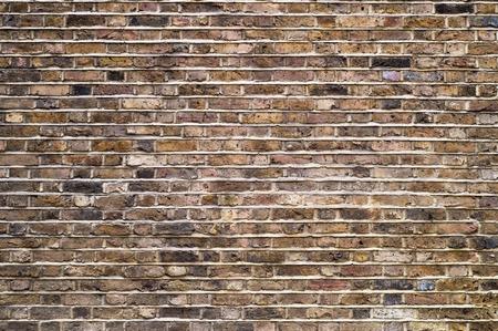 오래 된 벽돌 벽 배경의 조각입니다.