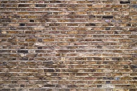 Fragment of an old brick wall background. Banco de Imagens