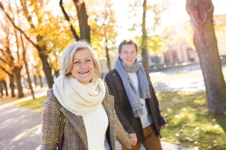 active: Active seniors on a walk in autumn town