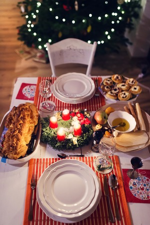 christmas tree: Christmas meal laid on a table in a decorated living room