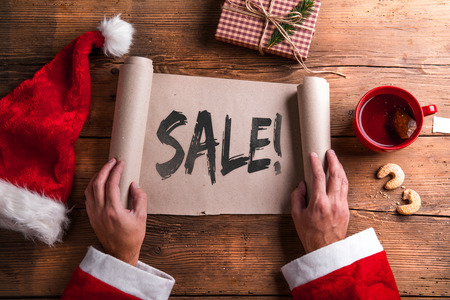 discount banner: Santa Claus holding an empty wish list in his hands Stock Photo