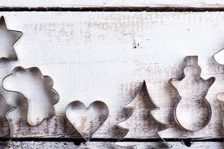 cookie cutter: Christmas composition. Studio shot on white wooden background.