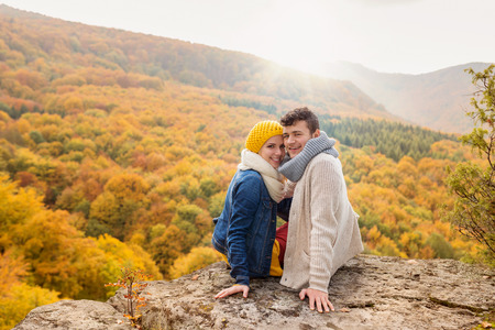 Beautiful young couple on a hike in autumn forest