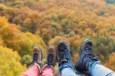 hiking shoes: Unrecognizable young couple on a hike in autumn forest
