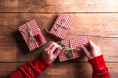 traditional gifts: Christmas presents laid on a wooden table background Stock Photo