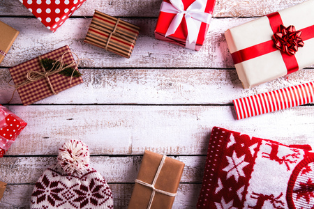 Christmas presents laid on a white wooden table background