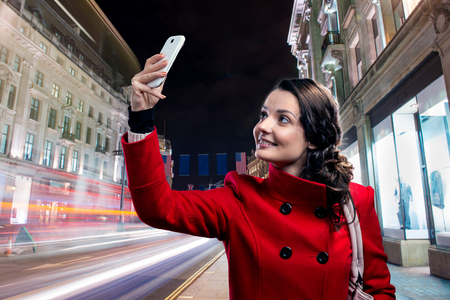 center city: Beautiful young woman taking selfie in the city