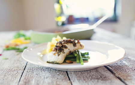 zander: Zander fish fillet dish on a plate on a wooden table Stock Photo