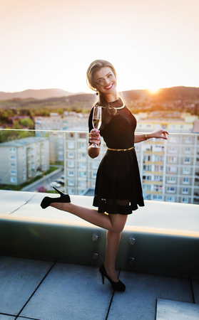 wine glass: Attractive young woman with a drink on a terrace of a bar Stock Photo