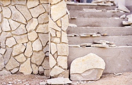 cantieri edili: Close up of an unfinished  stairs and stone wall