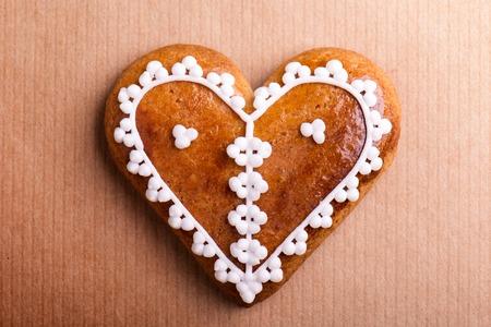 gingerbread heart: Gingerbread heart. Studio shot on paper background.