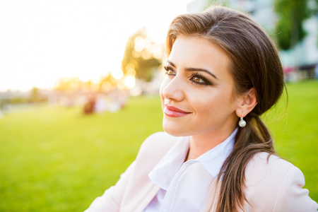 woman white shirt: Beautiful young business woman sitting in a park
