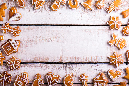moon flower: Christmas composition with gingerbreads. Studio shot on white wooden background.