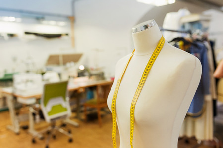 Tailors white textile dummy with yellow measure tape Zdjęcie Seryjne - 49036873