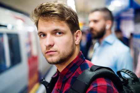 subway platform: Young handsome man on a subway platform