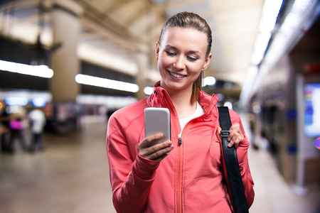 dark city: Young runner with smart phone in the city Stock Photo