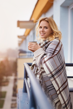 Beautiful woman relaxing at home with cup of  coffee Stock Photo