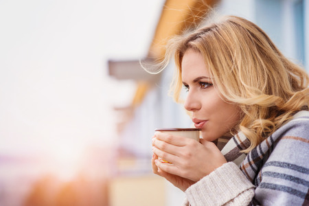 blanket: Beautiful woman relaxing at home with cup of  coffee Stock Photo