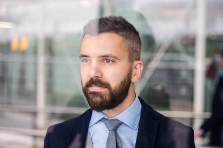 man with beard: Double exposure of a handsome young businessman Stock Photo