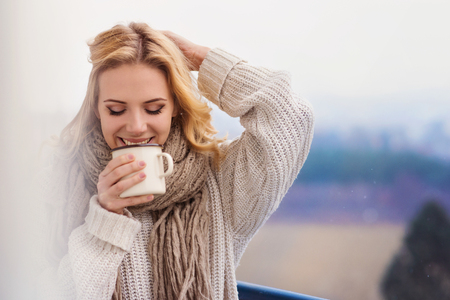 girl home: Beautiful woman relaxing at home with cup of  coffee Stock Photo