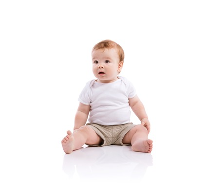 Happy little boy. Studio shot on white background. Reklamní fotografie