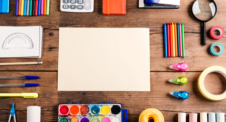 pen and paper: Desk with stationary and copy space. Studio shot on wooden background. Stock Photo