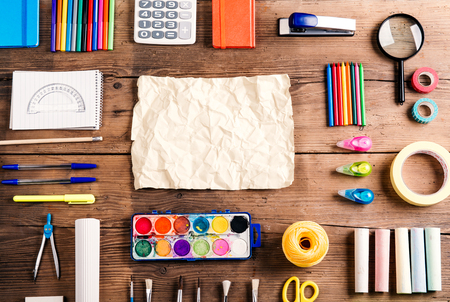 crayon  scissors: Desk with stationary and copy space. Studio shot on wooden background. Stock Photo