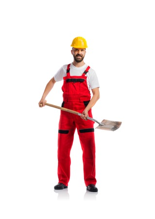 construction workers: Young handsome worker in red overalls. Studio shot on white background