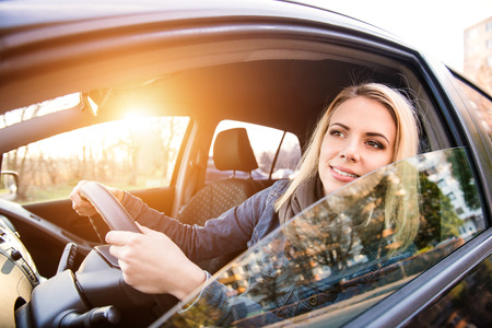 double glass: Beautiful young blond woman driving a car Stock Photo