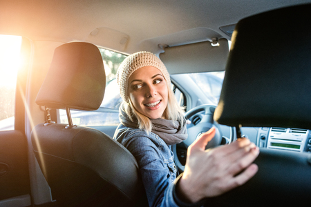 Beautiful young blond woman driving a car Stock Photo
