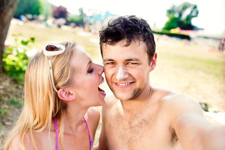 boy body: Beautiful young couple having fun outside on the beach