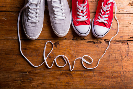 wooden shoes: Love composition. Studio shot on wooden background.