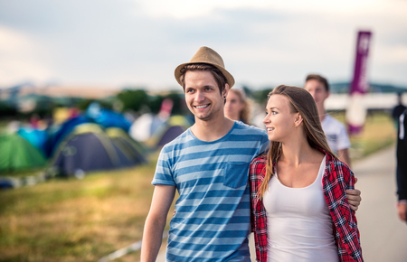 Beautiful young couple at summer tent festival Stock Photo