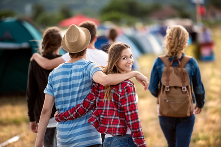 Beautiful young friends at summer tent festival