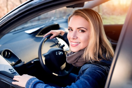 buyer: Beautiful young blond woman driving a car Stock Photo