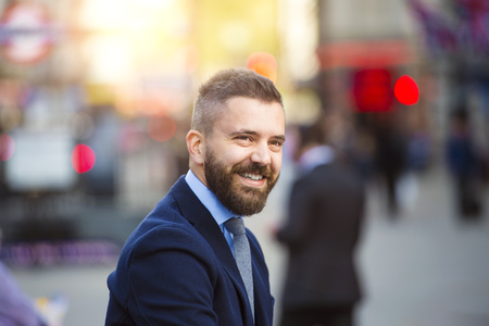 Close up of hipster manager in the crowded street of London, Piccadilly Circus Stock Photo