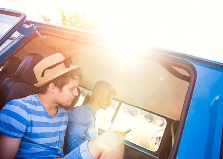 campervan: Teenage boys sitting inside an old campervan on a roadtrip, sunny summer day