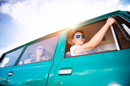 roadtrip: Teenagers inside an old campervan on a roadtrip, sunny summer day
