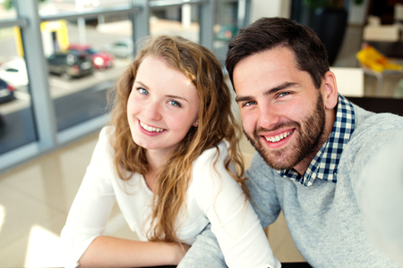 romantic man: Close up of beautiful young couple in love sitting in cafe taking selfie