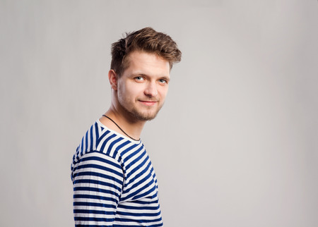 white long sleeve: Hipster man in striped black and white long sleeve t-shirt. Studio shot on gray background